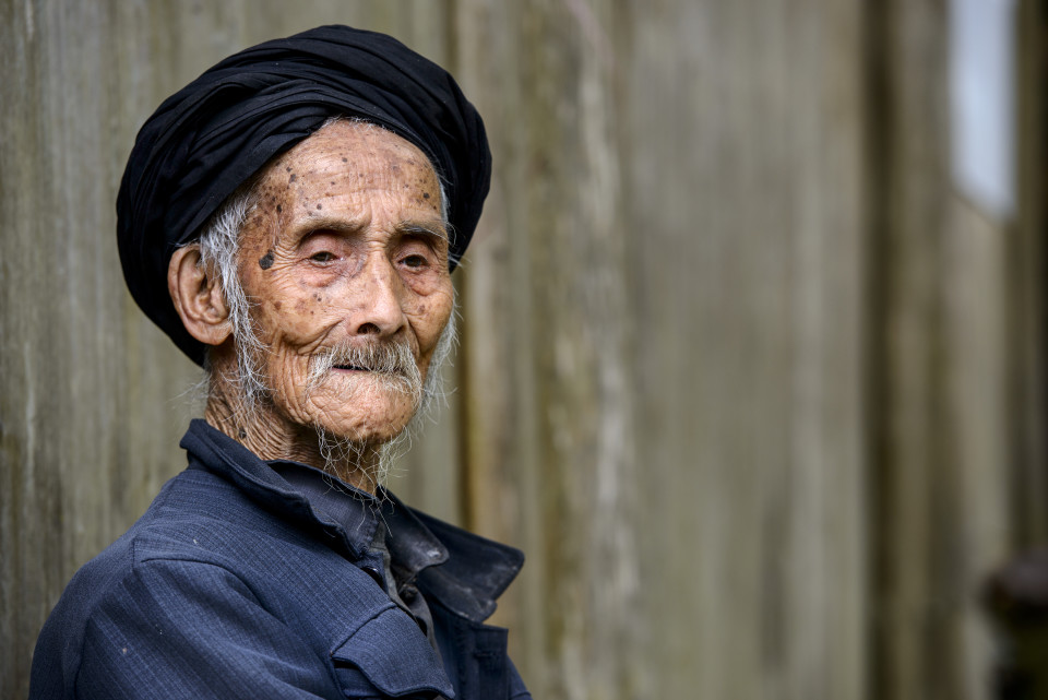 An elderly member of the Yao minority people in Tiantou Village, Guangxi, China.