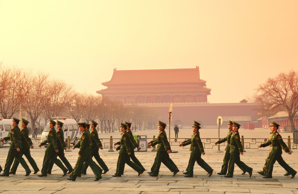 BEIJING, CHINA - APR 1: Team of soldier walk by Tiananmen in the morning on April 1, 2013 in Beijing, China. It is a famous monument in Beijing and serves as a national symbol.